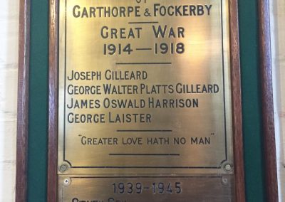 Brass plaque with the names of the fallen